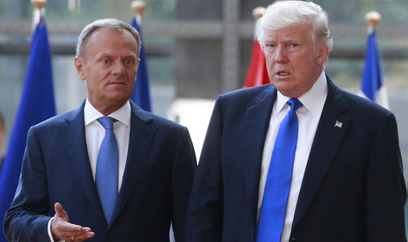 Donald Tusk greets Donald Trump ahead of a meeting