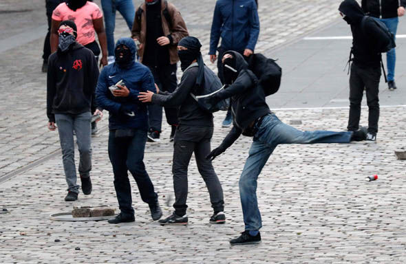 Protestors throw missiles ahead of the Le Pen rally