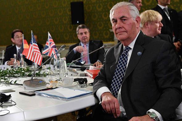 Rex Tillerson sitting during the G7 summit