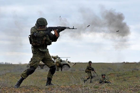 Russian soldier firing their weapons