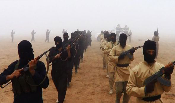 Masked Islamic State gunmen march in one of the terror group's propaganda videos