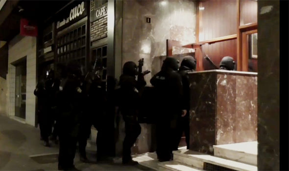 Spain police raid