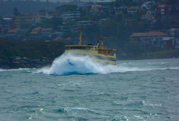 The monster waves come as a developing weather system rolls through Sydney