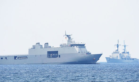 Tension: Ships sail in the South China Sea — practicing their right