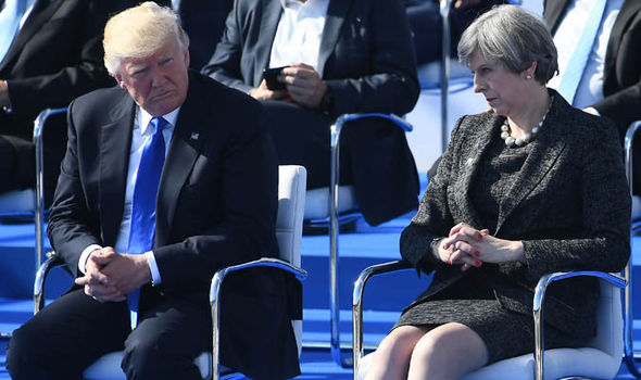 Theresa May scowls at Donald Trump