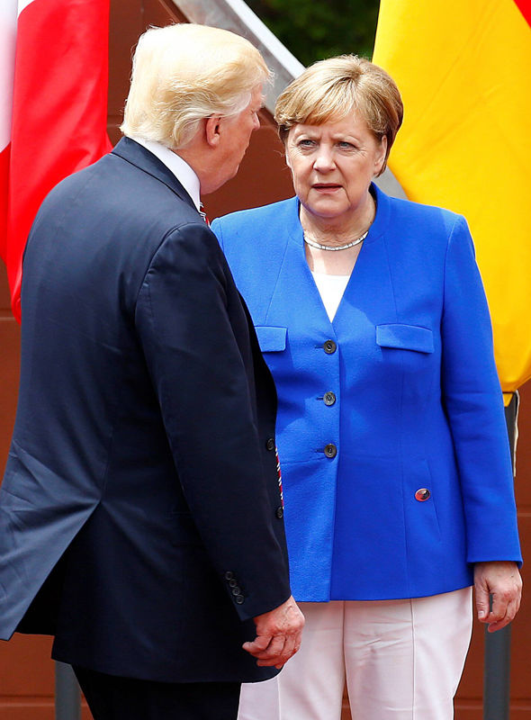 Frosty- Angela Merkel greets Donald Trump at the G7 summit