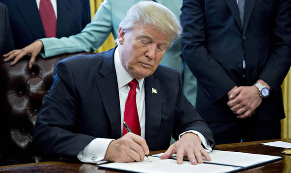 Donald Trump signing an executive order