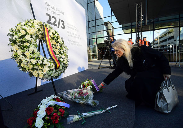 Woman lays flowers at Brussel airport memorial