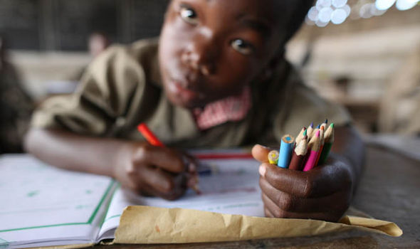 Child with colouring pens