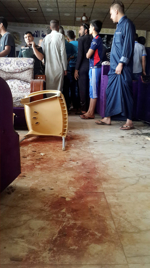 Blood stains are seen at a cafe after the attack
