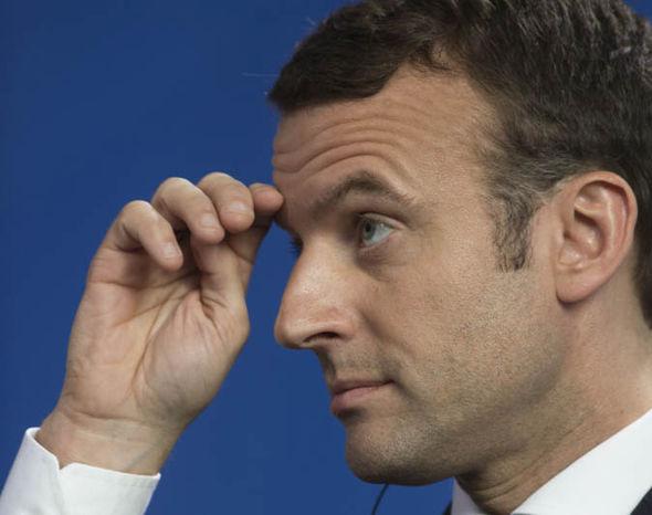 Emmanuel Macron looking flustered