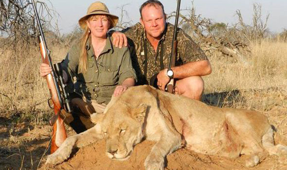 woman with dead lioness