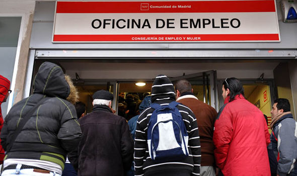 People queue up at a job centre in Madrid