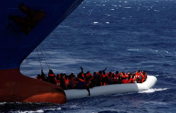 Asylum seekers in a rescue boat