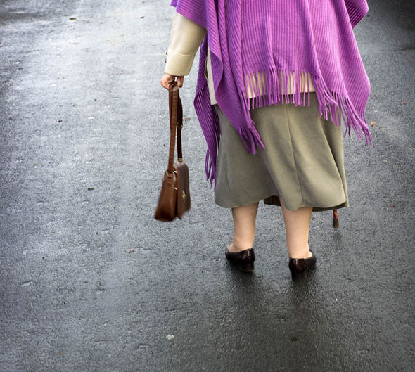 Old woman walking with a stick