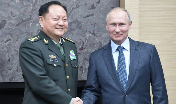 Chinese commander Zhang Youxia and Vladimir Putin
