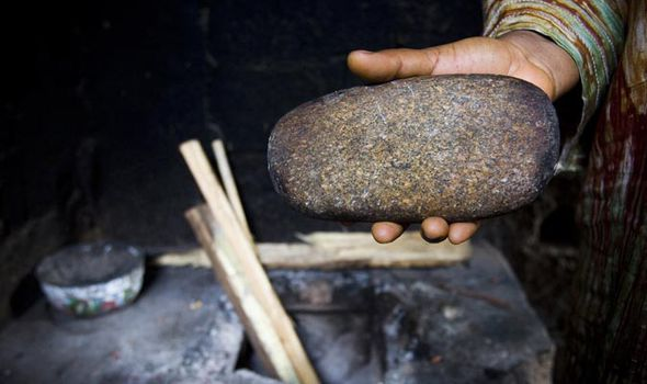 Hand holding stone