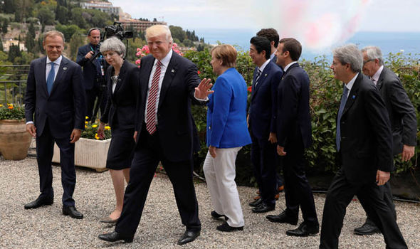 G7 country leaders meeting for walk