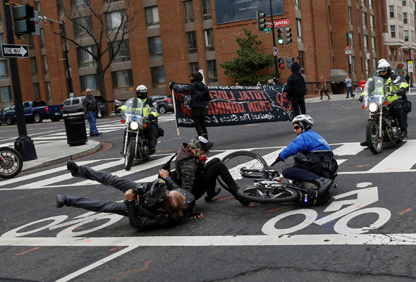 Protesters clash with police while demonstrating against President Trump