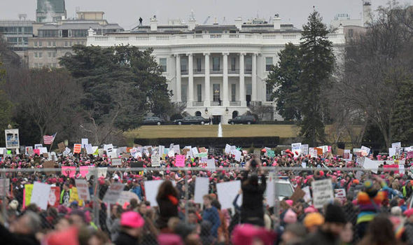 Demonstrators protest outside the White House in Washington, DC, for the Women's March