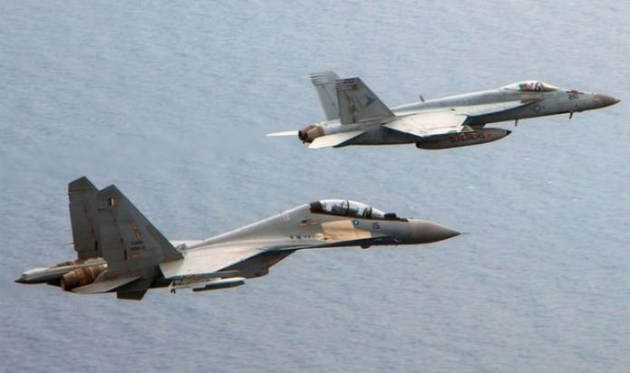 South China Sea war fears surge as US backs Malaysia over Beijing warplane 'intrusion'