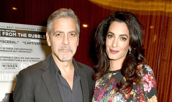 George and Amal Clooney at a Netflix premiere last month