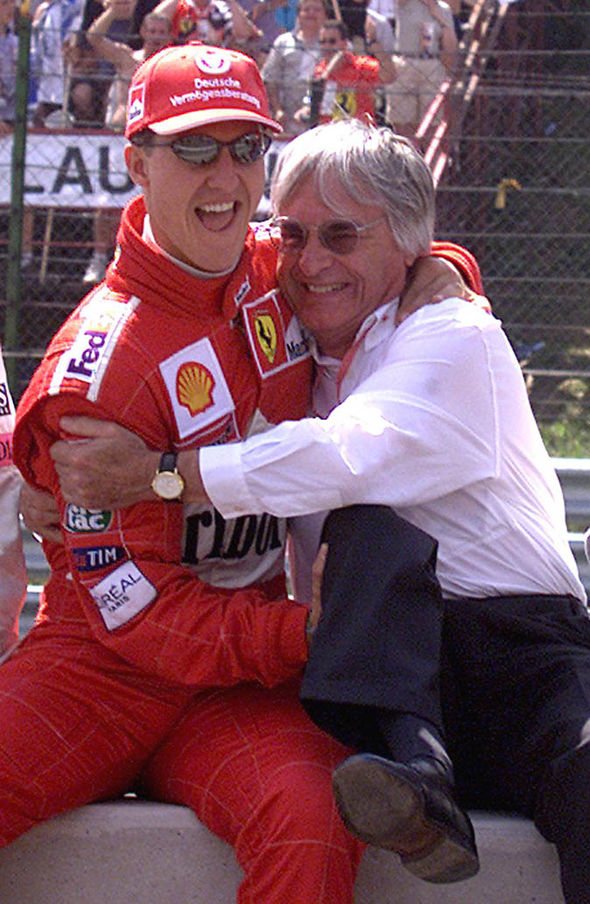 Michael Schumacher jokes with Bernie Ecclestone