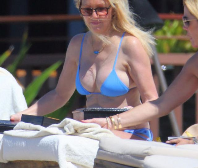 Heather Locklear  Almost Spills Out Of Tiny Bikini Top In