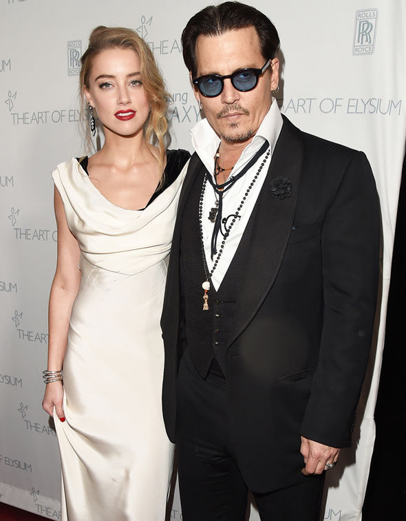 Johnny Depp Amber Heard managers lawsuit $2 million month