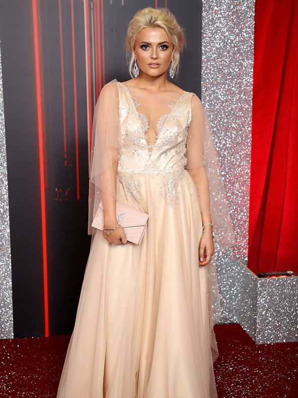 Lucy Fallon in floor-length gown