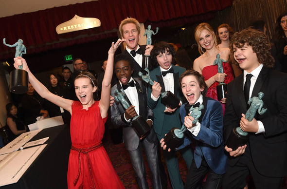 Millie Bobby Brown with Stranger Things cast