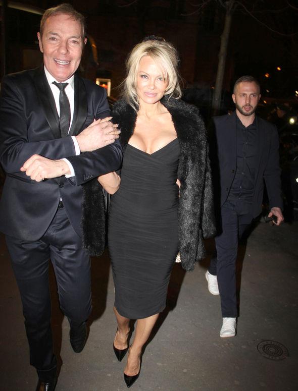 Pamela Anderson Paris cleavage black dress