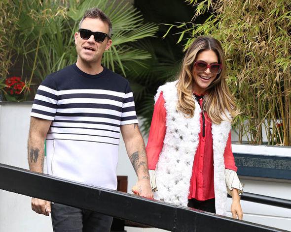 Robbie Williams and Ayda Field walking