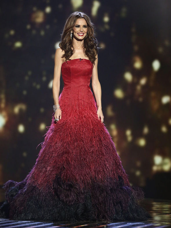 Cheryl Fernandez-Versini wears a red gown