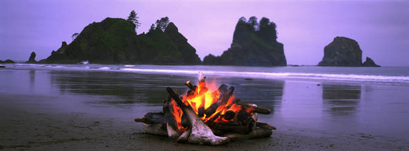 Fire burning on a remote beach