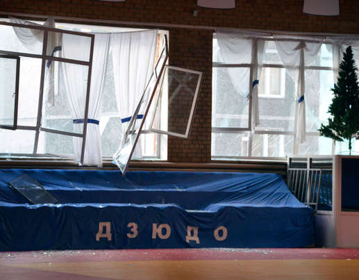 Broken windows and debris are seen inside a sports hall following sightings of a falling object in the sky
