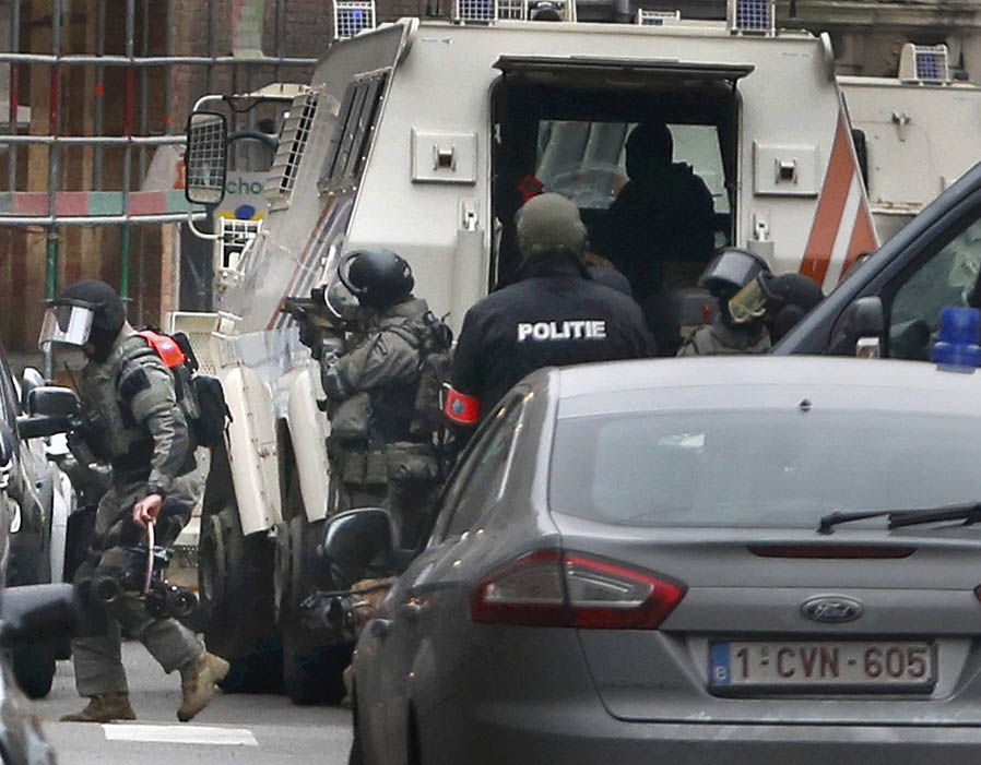 Police at the scene of a security operation in the Brussels suburb of Molenbeek in Brussels, Belgium.