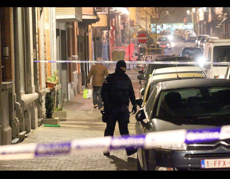 Police in Brussels were seen searching a top floor flat in the suburb of Schaerbeek, to find an Islamic State flag and explosives