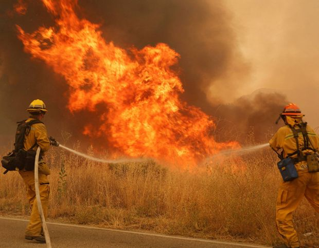 Firefighters tackle the Sand Fire in Santa Clarita, California, USA, 24 July 2016. Reports state that the fire has burned at least 18 structures and killed one person near Los Angeles