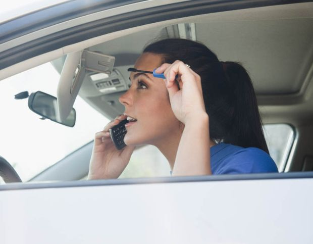 Applying make-up at the wheel  - This bad habbit could lead to a prosecution for driving without due care and attention, more commonly referred to as 'careless driving'.