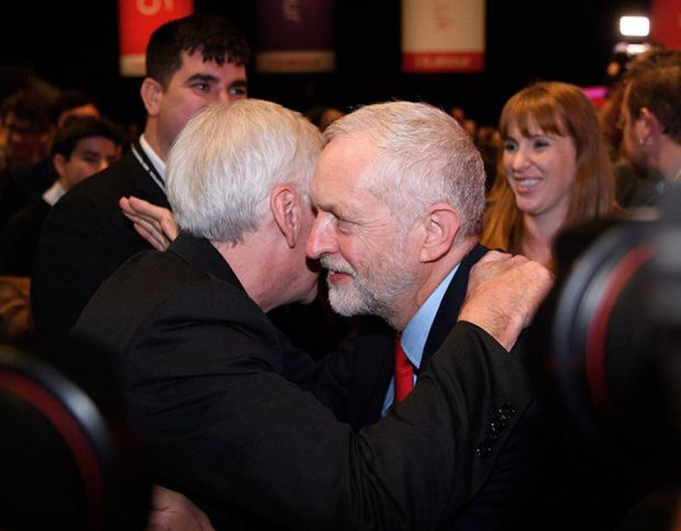 Jeremy Corbyn MP (R) hugs Shadow Chancellor John McDonnell after being announced as the leader of the Labour Party on the eve of the party's annual conference at the ACC on September 24, 2016