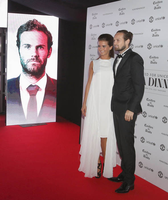 Daley Blind and Candy-Rae Fleur look on in front of a portrait of Mata