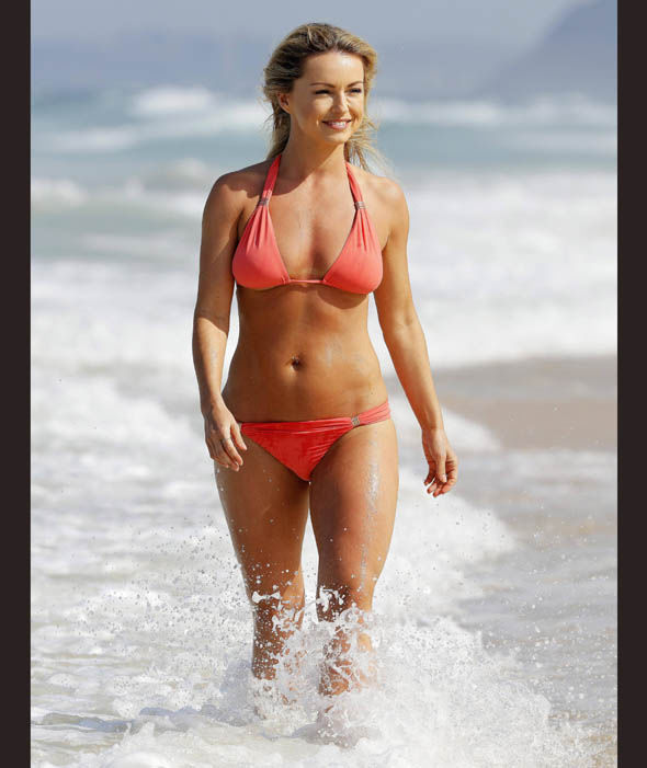 Ola Jordan cools off in the surf