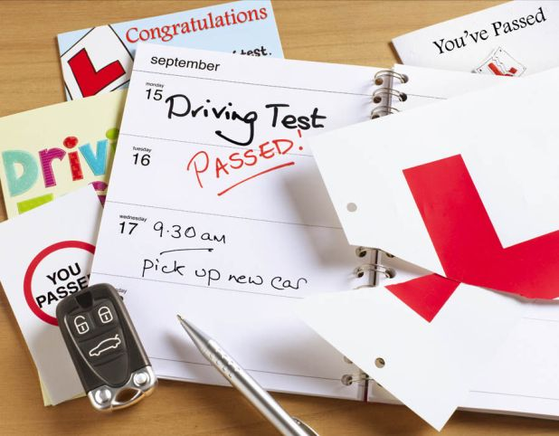 Driving test diary and L plates.