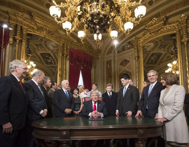 US President Donald J. Trump is joined by the Congressional leadership and his family as he formally signs his cabinet nominations into law.