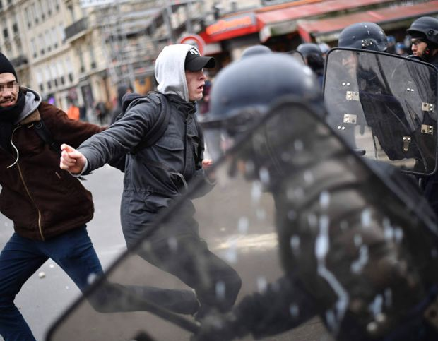 Members of the riot police charge at demonstrators during a protest of students against police brutality, following the alleged rape of Theo in Paris