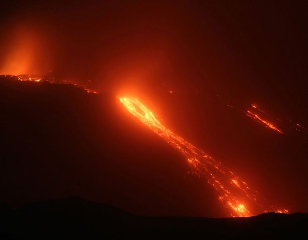 View of lava flows from Trecastagni, Zafferana, Giarre, Fornazzo as Mount Etna continues to erupt; the flows that start from the south east crater pour into the Valle del Bove