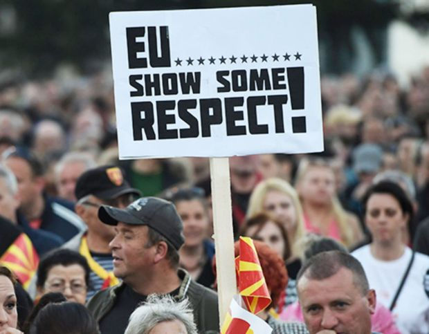 A protestor makes their EU views known