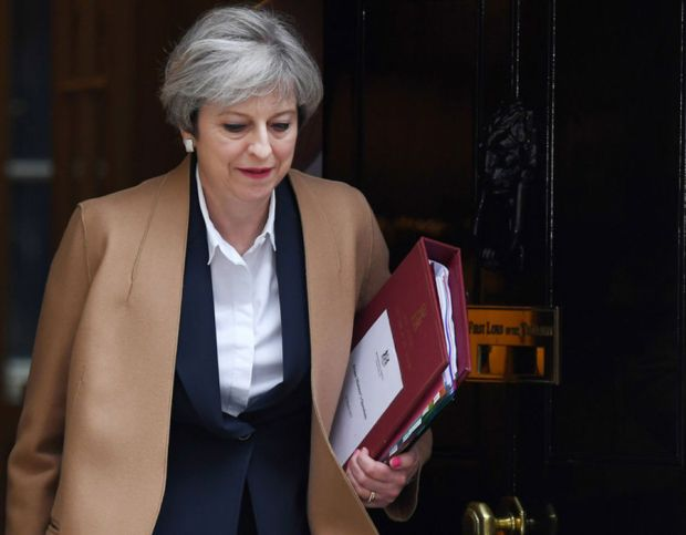 Theresa May leaves 10 Downing Street to make a statement to Parliament, officially triggering Article 50