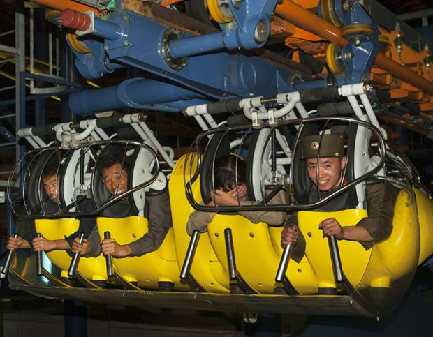 Soldiers enjoy a ride at the funfair in Pyongyang